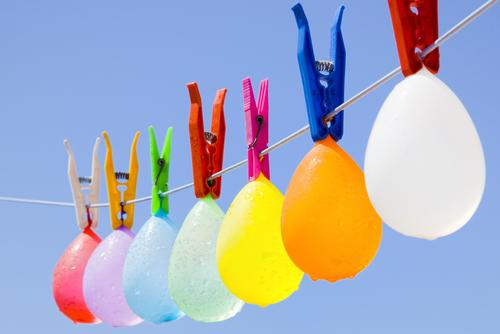 Balloons with water drops hanging on a clothesline