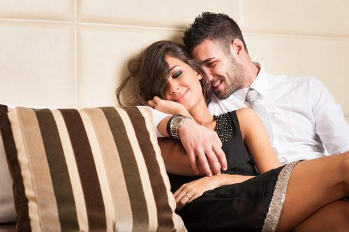 Happy young couple relaxing in hotel room