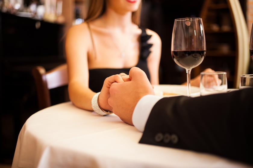 Couple holding hands at a restaurant