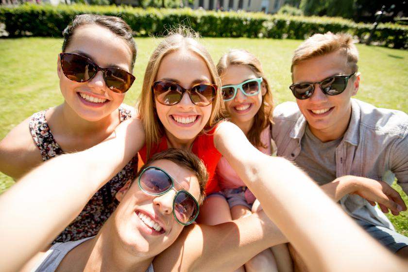 Group of friends taking a selfie at the park
