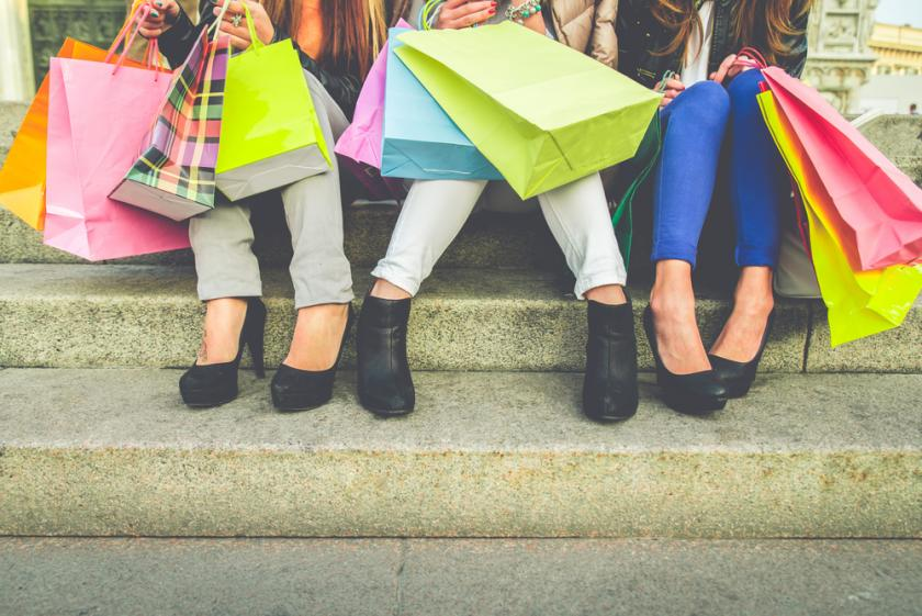 Women with high heels and shopping bags