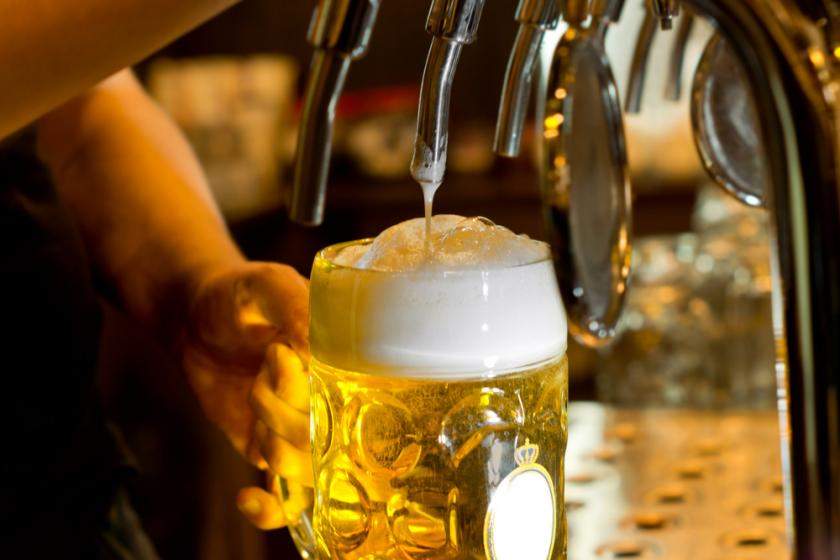 Man pouring beer into glass