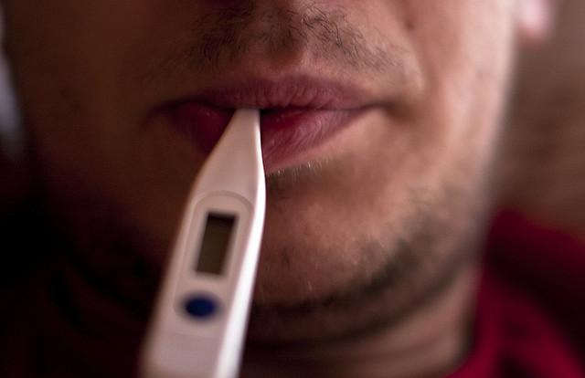 Man with thermometer in mouth