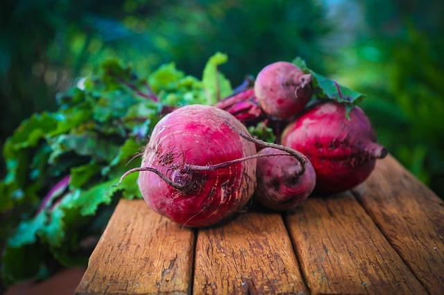 Beets on wooden surface