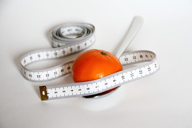 Fruit with measuring tape around