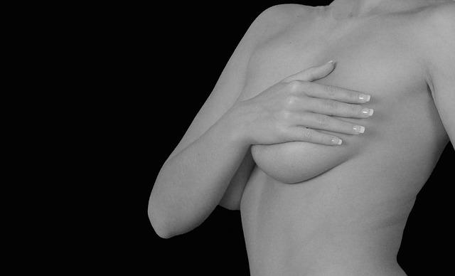 Women holding breasts