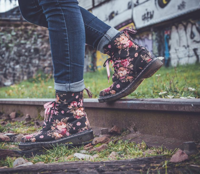 Woman walking with flower boots