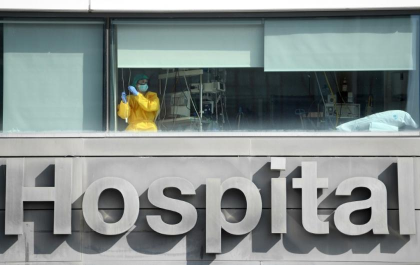 a-healthcare-worker-looks-out-the-window-of