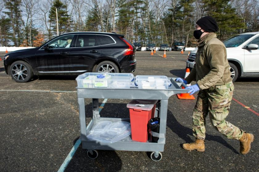 a-us-national-guard-soldier-pushes-a-cart