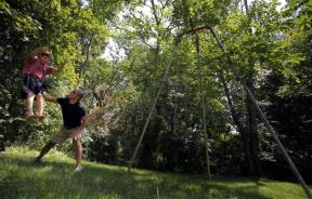 Ed Damiano pushes his son David on a swing in the family's backyard in Acton, Massachusetts July 23, 2011.