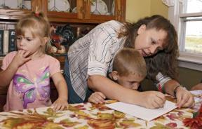 Christa Keagle works with her children Rebekah, 3, and Joshua Keagle, 6, during a homeschool assignment in St. Charles, Iowa September 30, 2011.