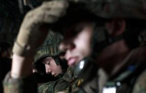 Soldiers of the 1st German paratroop battalion 331 sit onboard an Air Force C-130J transport plane for a training flight at the air base in Ramstein February 23, 2012.
