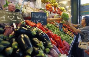 woman buys vegetables, fruits