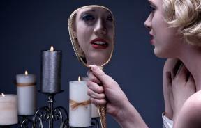 Crying woman looking into mirror
