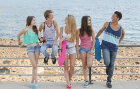 Teens outdoors on the boardwalk in the sun