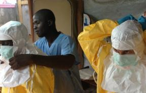 Ebola workers work to contain the virus