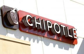 Woman Uses Chipotle Dining Table as a Changing Station