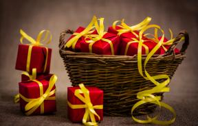 Basket full of red wrapped gifts