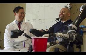 Paralyzed Man, Erik Sorto, Takes Sip Of His Beer With The Help Of Robotic Arm And Brain Implants