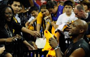 Lamar Odom signs autographs for fans.