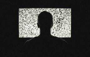 Man in front of TV