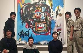 Yusaku Maezawa (3rd from left) and his $110 million painting, Untitled, by Basquiat