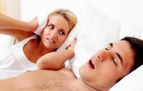 woman-cant-sleep-because-mans-loud-snoring