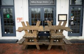 picnic-tables-block-the-closed-doors-of-abbey