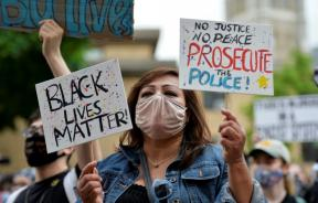 a-demonstrator-holding-a-black-lives-matter-sign
