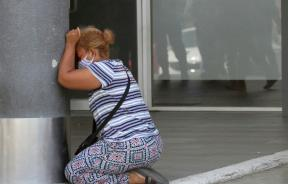a-woman-cries-after-learning-of-the-death