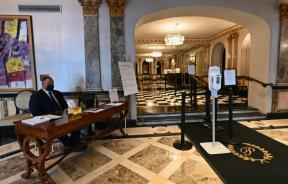 a-security-officer-sits-in-the-lobby-of