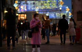 Woman Wearing Mask In London Shopping District