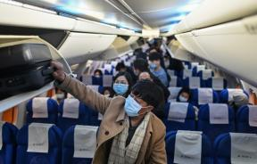 Airplane passengers wearing masks