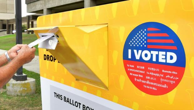 a-voter-drops-a-ballot-for-the-us